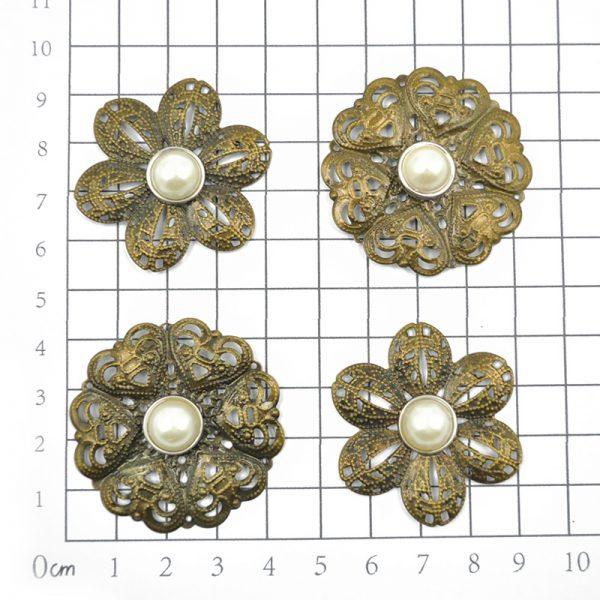 Metallic flower shape trinkets for scrapbooking